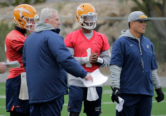 UTEP head coach Dana Dimel goes over a formation with two of his three quarterbacks, Ryan Metz and Kai Locksley, along with quarterbacks coach/offensive coordinator Mike Canales, right, during practice Oct. 15 as the team prepared for Louisiana Tech on Saturday in Ruston, La.