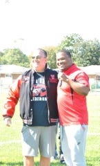 Vineland mayor Anthony Fanucci, left, proudly wears his championship jacket delivered by the Vineland Bandits.