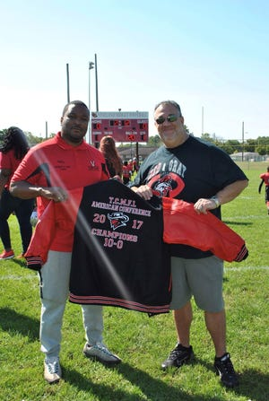VMFL president Chris Wilson, left, and Vineland mayer Anthony Fanucci pose for a picture on Sept. 30