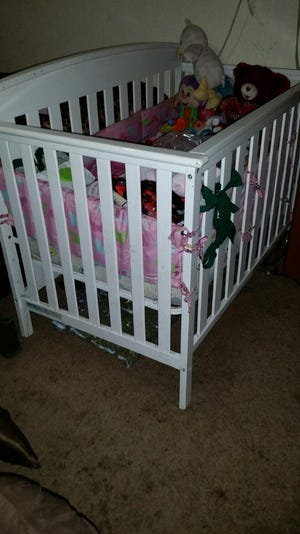 Tulare County detectives found large amounts of marijuana in a crib at a Dinuba home.