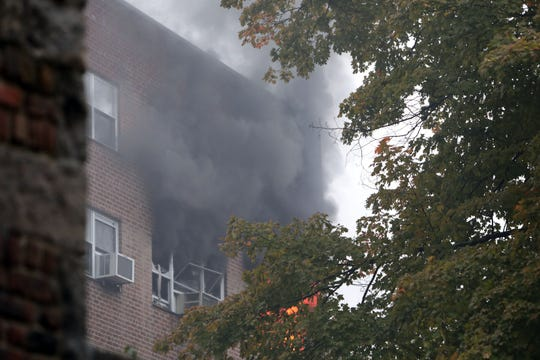 Firefighters battle an apartment fire on the 5th floor of 235 Garth Road in Eastchester Oct. 15, 2018. Eastchester fire department had help from Hartsdale, Greenville, New Rochelle, Yonkers and Mount Vernon fire departments.