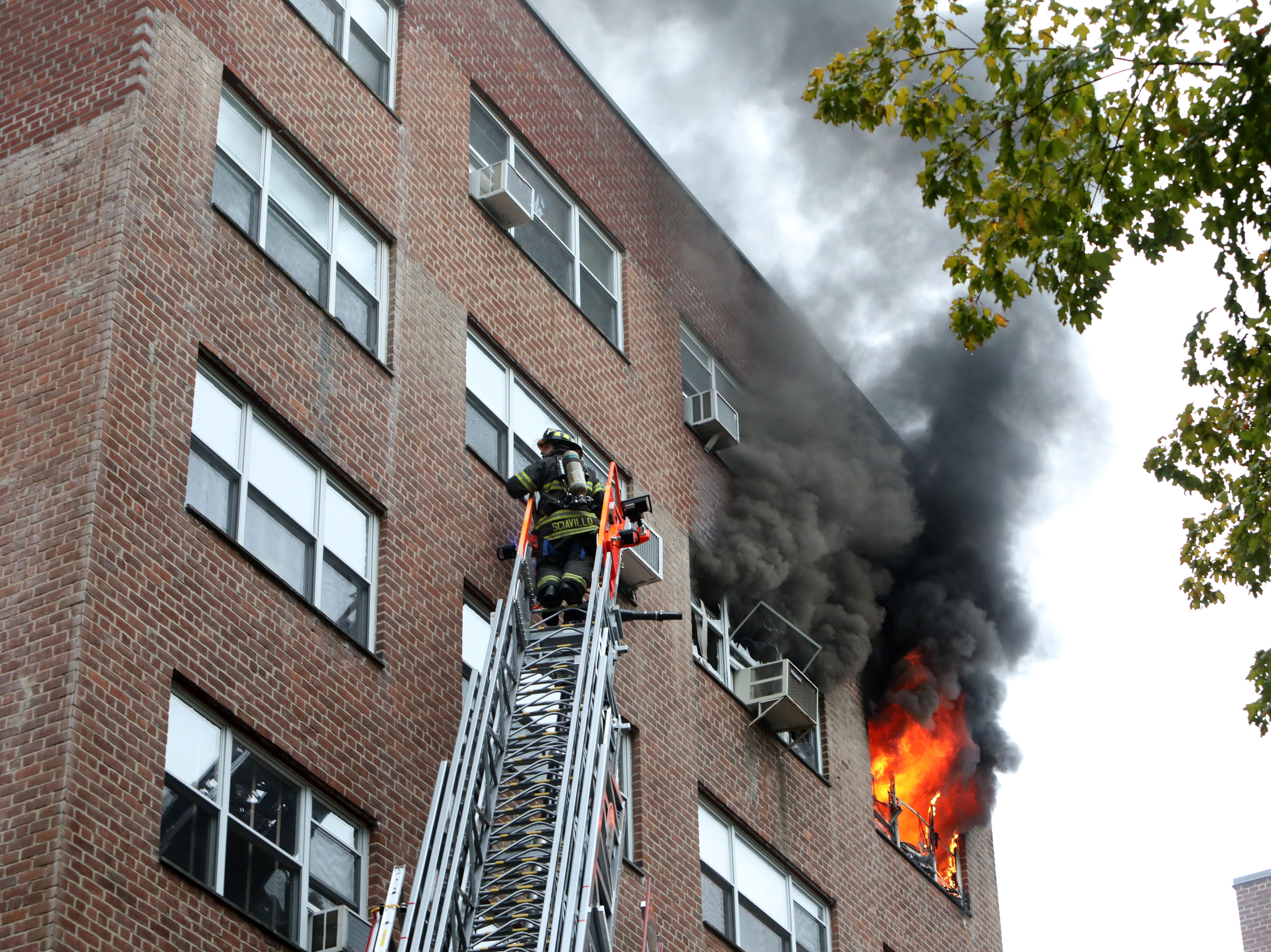 Flames pour out of a 5th floor apartment at 235 Garth Road in Eastchester Oct. 15, 2018. Eastchester firefighters had help from Hartsdale, Greenville, New Rochelle, Yonkers and Mount Vernon fire departments.