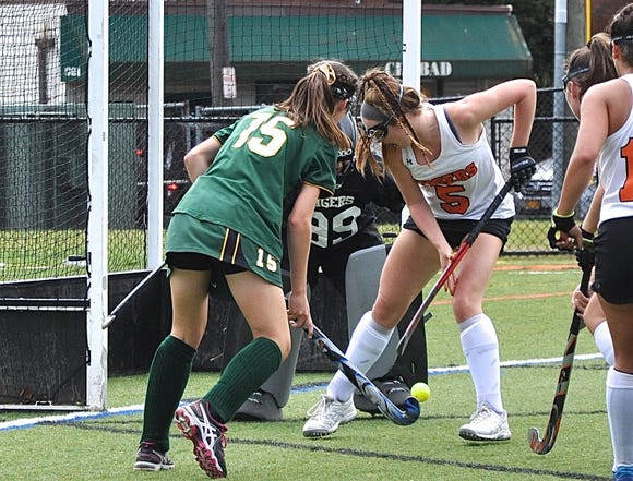 Lakeland's Cara O'Shea (15) pressures ball as Mamaroneck's Sophie Showers (5) defends in front of goalie Samantha Maresca during game last month.