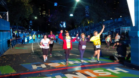 Sal Pellegrino (in red jacket) at the finish line of the 2015 New York City Marathon, when he volunteered as a guide for Achilles International.