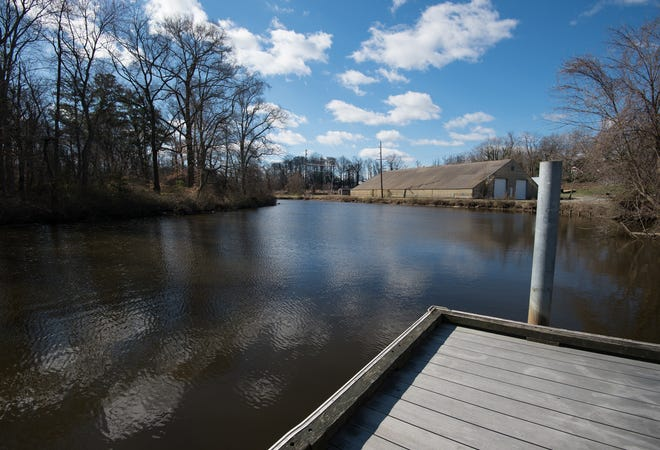 View of the St. Jones River adjacent to Kent County's sewage pump station 3, located on Water Street in Dover.