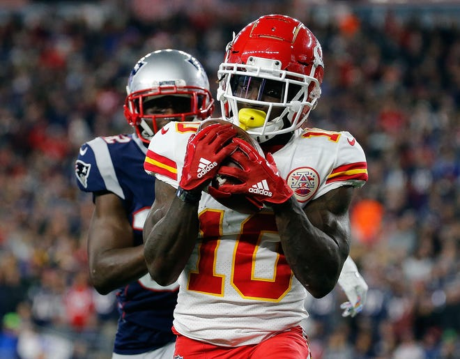 Chiefs wide receiver Tyreek Hill catches a touchdown pass in Sunday's game against the Patriots.