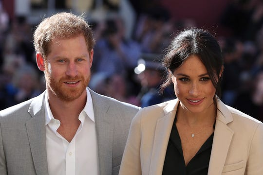 Prince Harry and Duchess Meghan of Sussex greet well wishers during their visit to Chichester, England, Oct. 3, 2018.