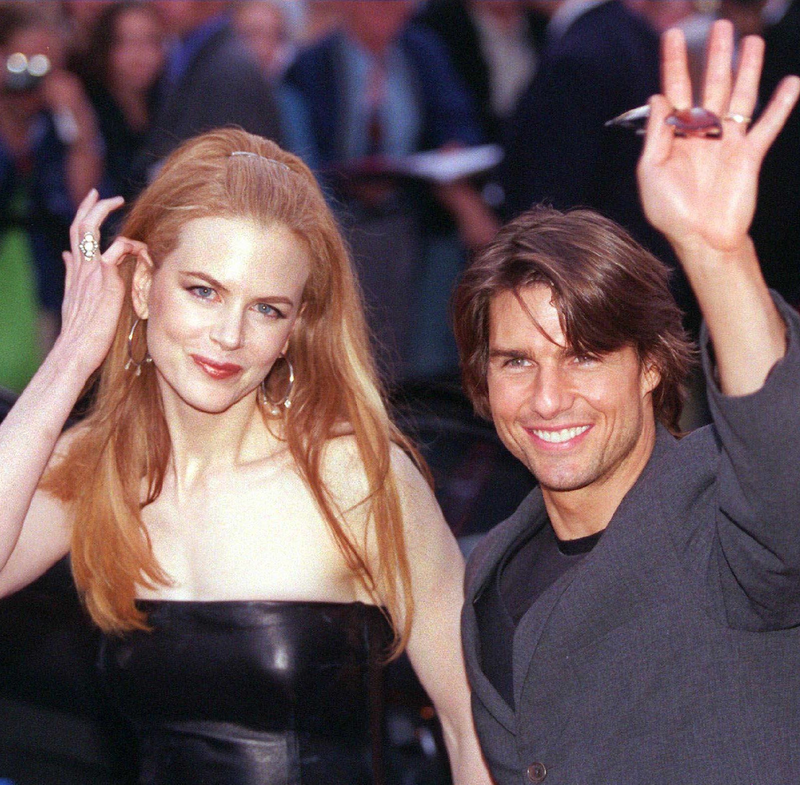 "Nicole Kidman says her marriage to Tom Cruise shielded her from sexual harassment due to his star-power. Here, the former couple and co-stars arrive for the German premiere of ""Eyes Wide Shut"" in September 1999."