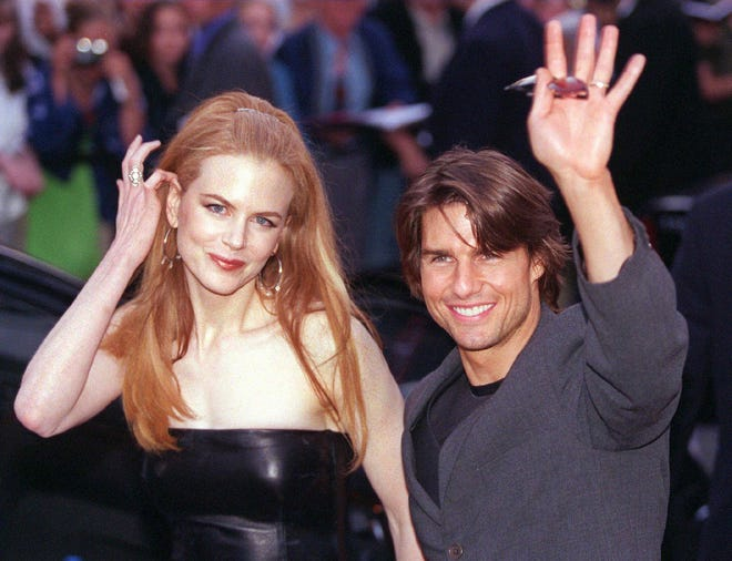 """Nicole Kidman says her marriage to Tom Cruise shielded her from sexual harassmentdue to his star-power.Here, the former couple and co-stars arrive for the German premiere of """"Eyes Wide Shut"""" in September 1999."""