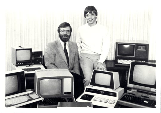 Microsoft co-founders Paul Allen and Bill Gates are surrounded by personal computers shortly after signing a major contract with IBM to write software for their line of personal computers.