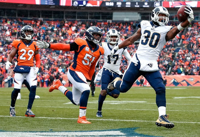 Todd Gurley runs for a touchdown against the Broncos.