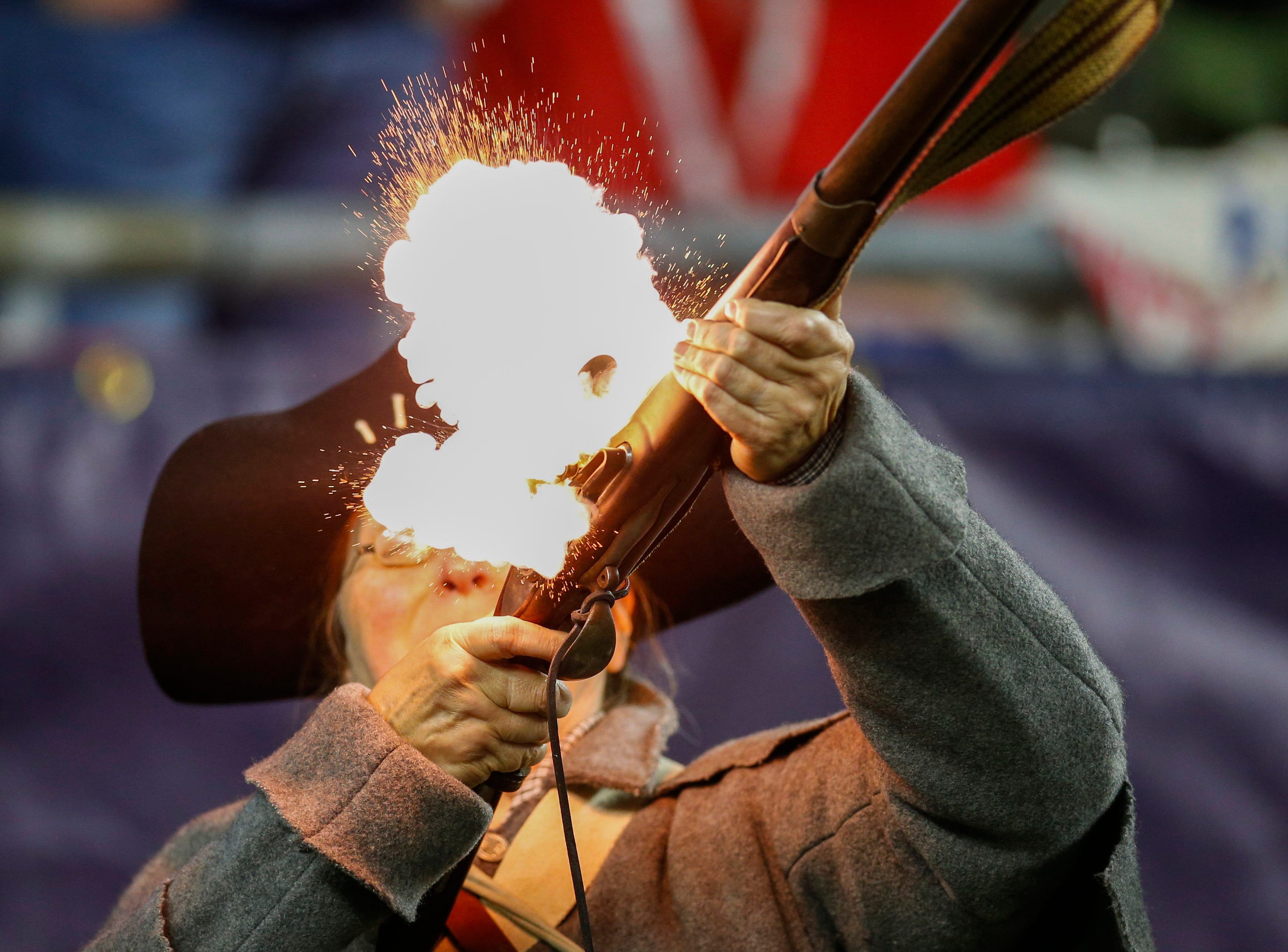 A New England Patriots end zone minuteman fires a musket during the game against the Kansas City Chiefs at Gillette Stadium.