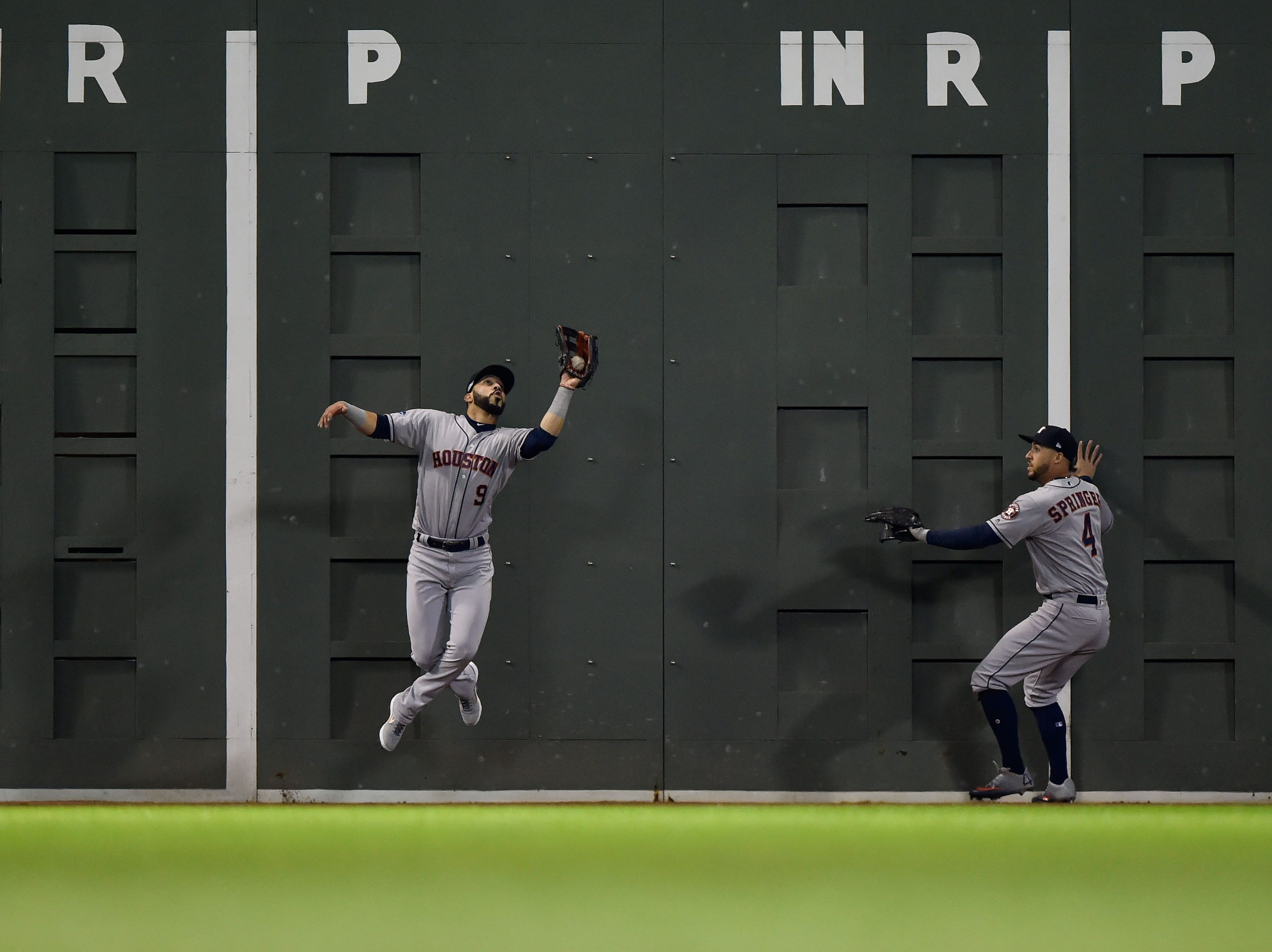 ALCS Game 2: Astros left fielder Marwin Gonzalez makes a catch in front of the green monster in the second inning.