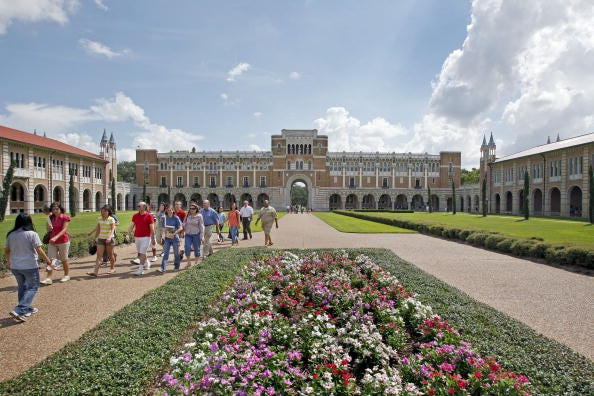 UNITED STATES - AUGUST 21:  New students and their parents walk outside Lovett Hall during an orientation tour on the campus of Rice University in Houston, Texas, U.S., on Friday, Aug. 21, 2009. Rice University President David Leebron said the merger of his university, the highest-ranked in Texas by U.S. News & World Report, with Baylor College of Medicine would help it compete with schools such as Harvard University, Stanford University and Yale University. Rice and Baylor have been in formal merger talks since March.  (Photo by Craig Hartley/Bloomberg via Getty Images)