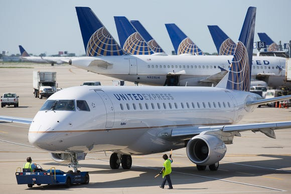 A United Express Embraer jet is pushed back for departure from Chicago O'Hare International Airport in June 2015.