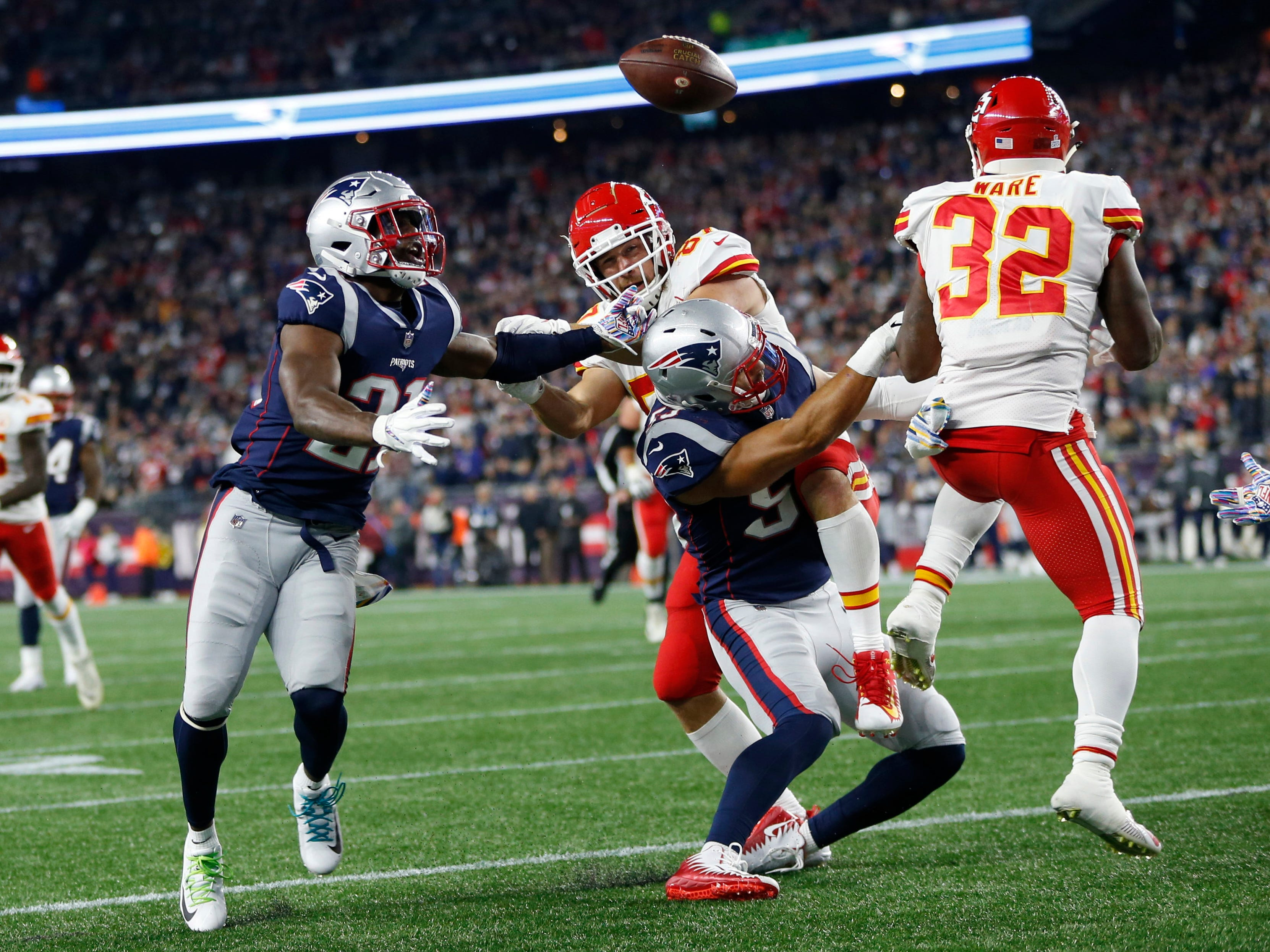 New England Patriots defensive back Duron Harmon (21) intercepts a tipped pass during the second quarter against the Kansas City Chiefs at Gillette Stadium.