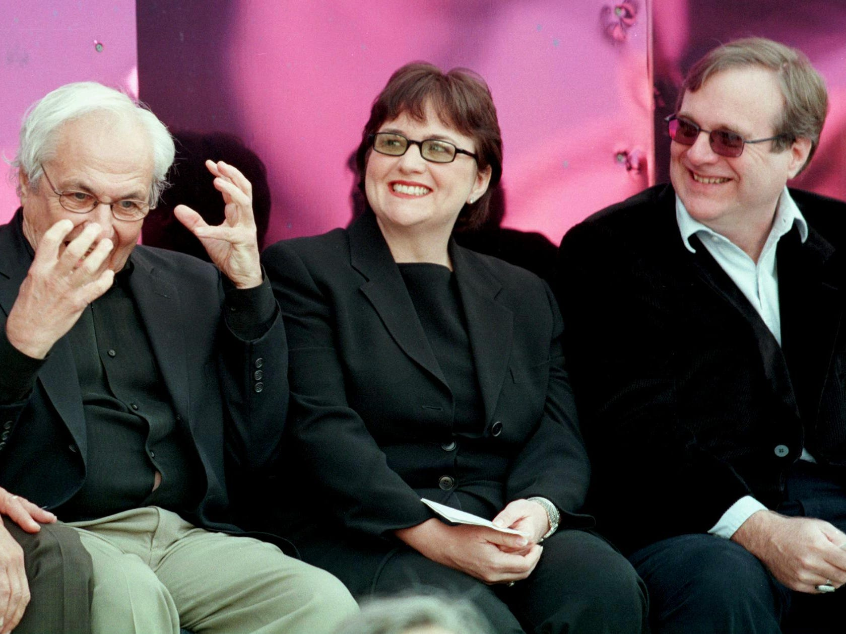 Experience Music Project museum architect Frank Gehry, left, speaks while museum co-founders Paul Allen, right, and Allen's sister, Jody Allen Patton, center, listen during the grand opening in Seattle, June 23, 2000.