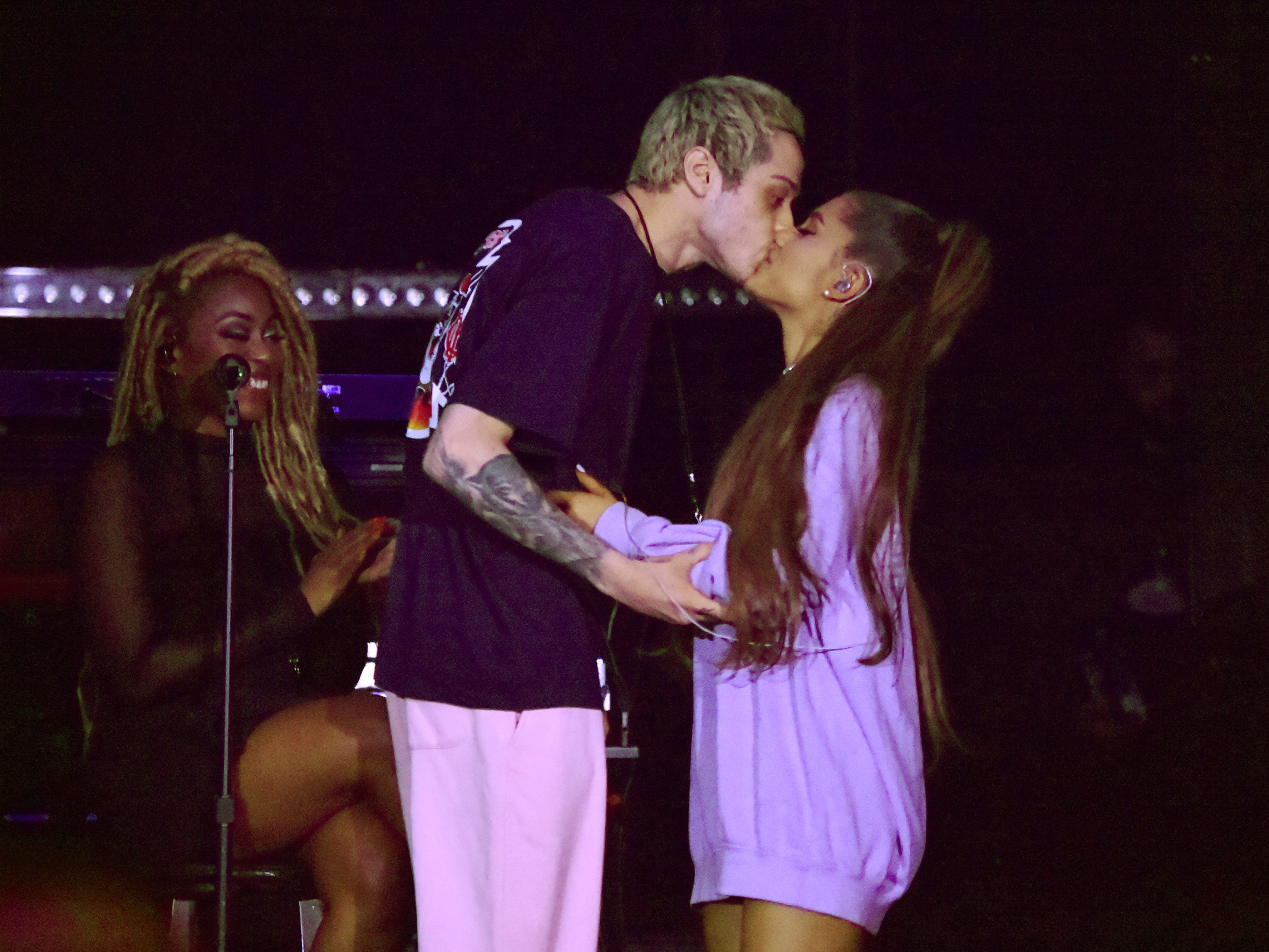 "Pete Davidson and Ariana Grande onstage at American Express and Ariana Grande present ""The Sweetener Sessions"" at Ace Hotel on August 25, 2018 in Los Angeles."