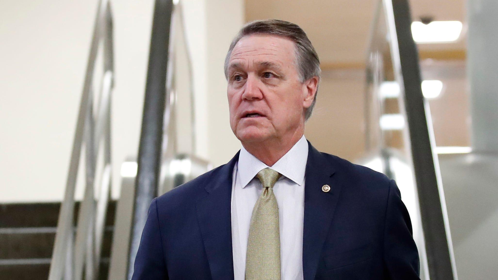 Sen. David Perdue, R-Ga., arrives on Capitol Hill, in Washington on Oct. 4, 2018.