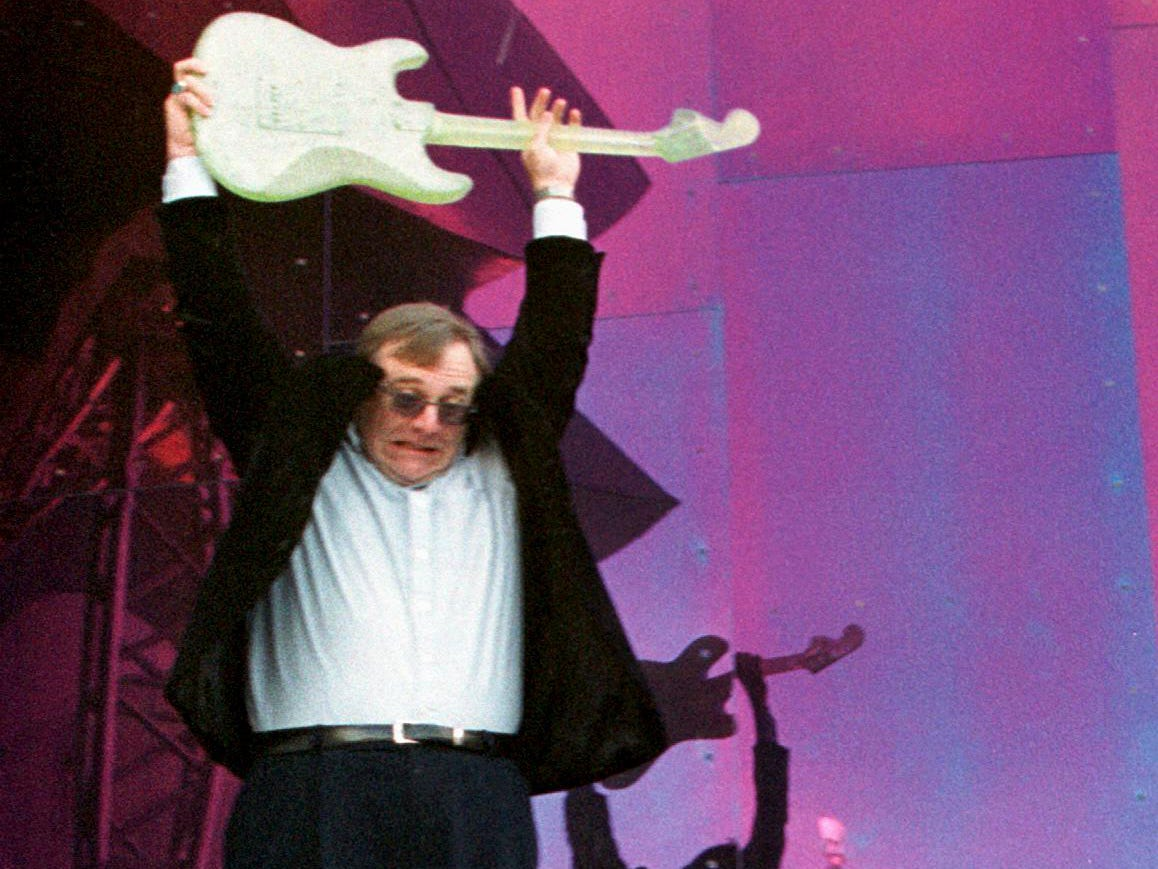 Paul Allen christens his Experience Music Project museum by smashing a glass guitar during its grand opening in Seattle, June 23, 2000.