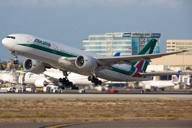 An Alitalia Boeing 777-200 takes off from Los Angeles International Airport on Sept. 23, 2017.