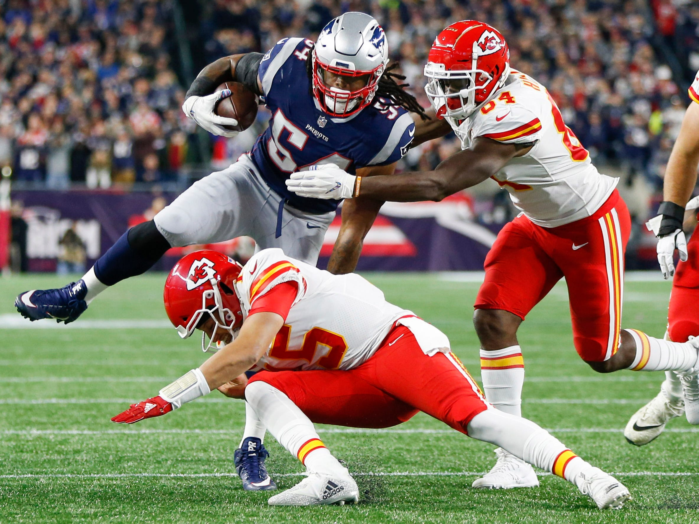 Kansas City Chiefs quarterback Patrick Mahomes attempts to tackle New England Patriots linebacker Dont'a Hightower after throwing an interception to Hightower during the first quarter at Gillette Stadium.