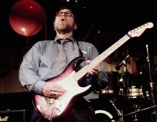 Microsoft co-founder and billionaire Paul Allen joins in with the band and plays electric guitar at an election night victory party in the early morning hours June 18,1997, in Seattle.