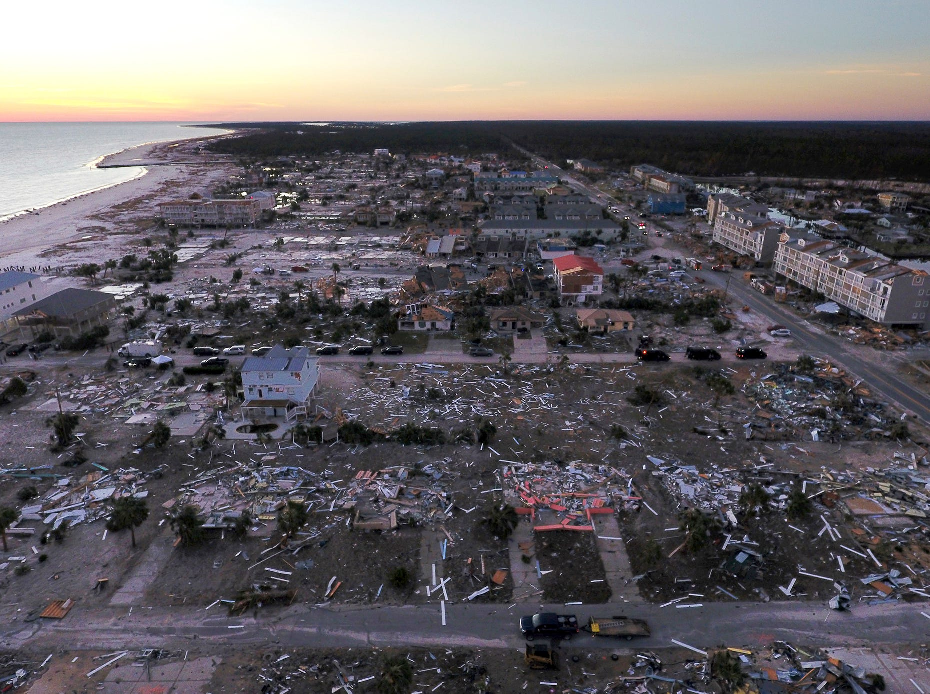 In this Oct. 12, 2018, file photo, damaged homes are seen along the water's edge in the aftermath of hurricane Michael in Mexico Beach, Fla. It was once argued that the trees would help save Florida's Panhandle from the fury of a hurricane, as the acres of forests in the region would provide a natural barrier to savage winds that accompany the deadly storms. It's part of the reason that tighter building codes, mandatory in places such as South Florida, were not put in place for most of this region until just 11 years ago. And it may be a painful lesson for area residents now that Hurricane Michael has ravaged the region.