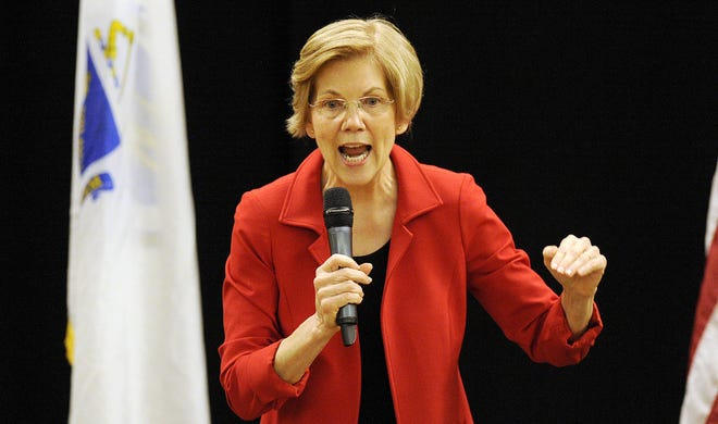 Sen. Elizabeth Warren, D-Mass., addresses a town hall meeting in Roxbury, Massachusetts, on Oct. 13, 2018.
