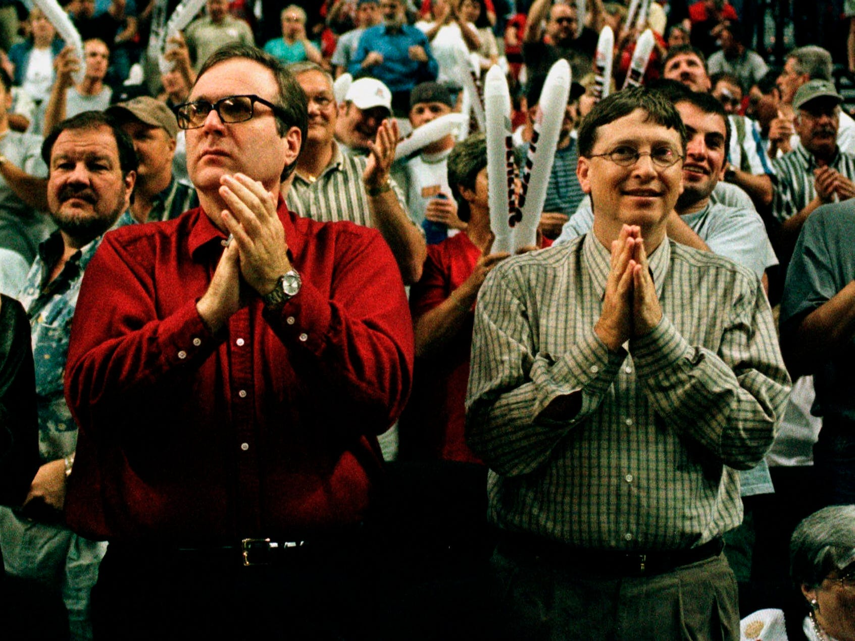 FILE- In this May 27, 1999, file photo, Portland Trail Blazers owner Paul Allen, left, is joined by Bill Gates as they cheer the Blazers against the Utah Jazz during NBA playoff action in Portland, Ore., May 27, 1999.