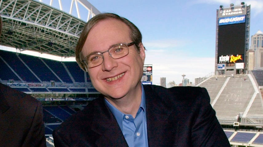 FILE - In this July 17, 2001 file photo, Seattle Seahawks owner Paul Allen appears in a suite in the team's stadium in Seattle. Allen, billionaire owner of the Trail Blazers and the Seattle Seahawks and Microsoft co-founder, died Monday, Oct. 15, 2018 at age 65. Earlier this month Allen said the cancer he was treated for in 2009, non-Hodgkin's lymphoma, had returned.  (AP Photo/Elaine Thompson, File) ORG XMIT: NYCL104
