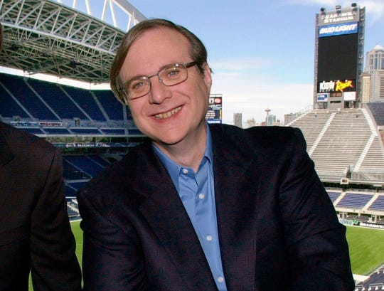 FILE - In this July 17, 2001 file photo, Seattle Seahawk's owner Paul Allen appears in a suite at the team's stadium in Seattle Allen, billionaire owner of the Trail Blazers and The Seattle Seahawks and Microsoft co-founder, who died Monday, Oct. 15, 2018 at age 65. Earlier this month, non-Hodgkin's lymphoma, had returned. (AP Photo / Elaine Thompson, File) ORG XMIT: NYCL104