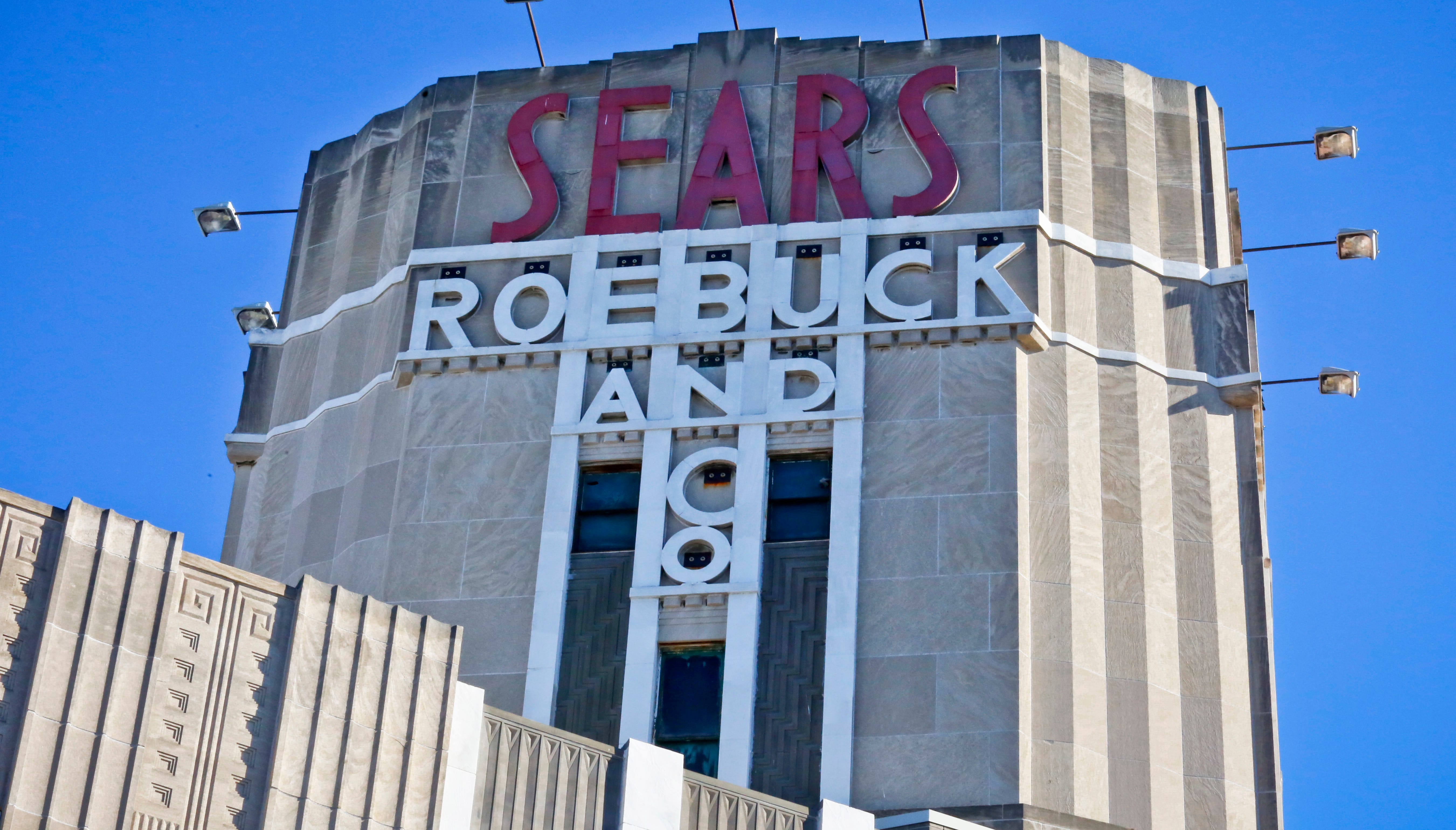 This Wednesday, March 22, 2017, photo, shows Sears signage on its department store in Brooklyn's Flatbush neighborhood, in New York.