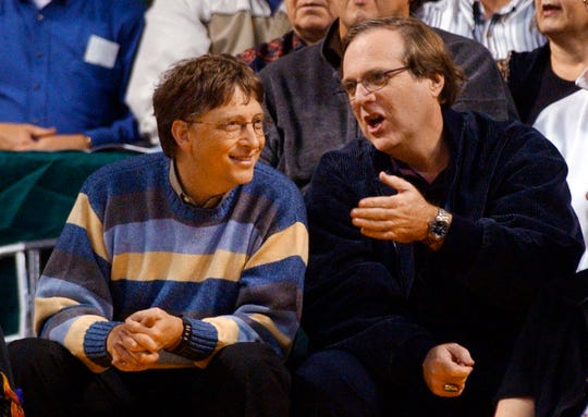 Microsoft chairman Bill Gates, left, with Portland Trail Blazer's owner Paul Allen during a game between the Blazers and Seattle trailers SuperSonics in Seattle, March 11, 2003.
