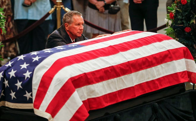 Ohio Gov. John Kasich pays respects as Sen. John McCain, R-Ariz., lies in state at the Capitol in Washington on Aug. 31, 2018.