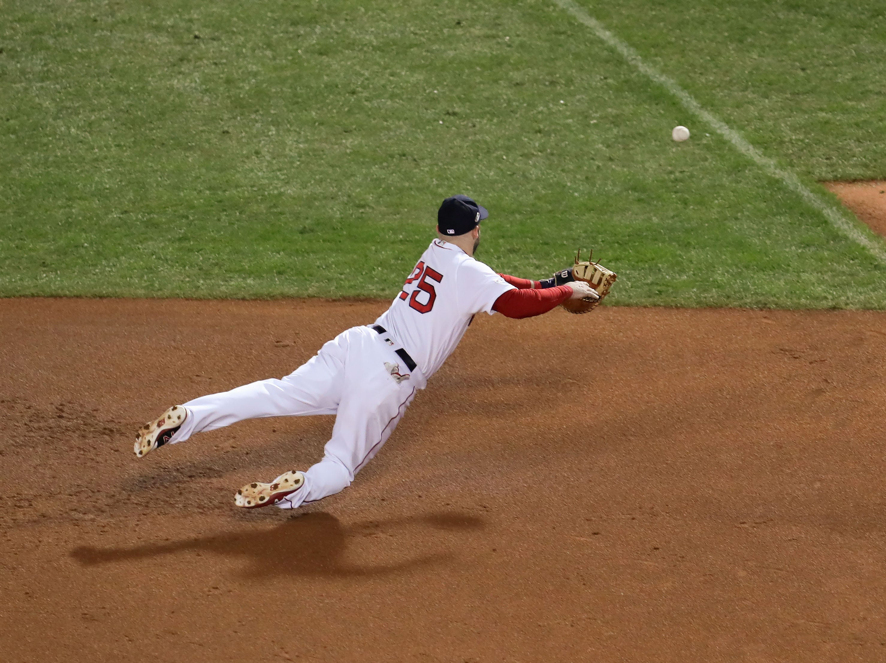 ALCS Game 2: Red Sox first baseman Steve Pearce dives but can't catch a ball hit by George Springer for a two-run double in the second inning.