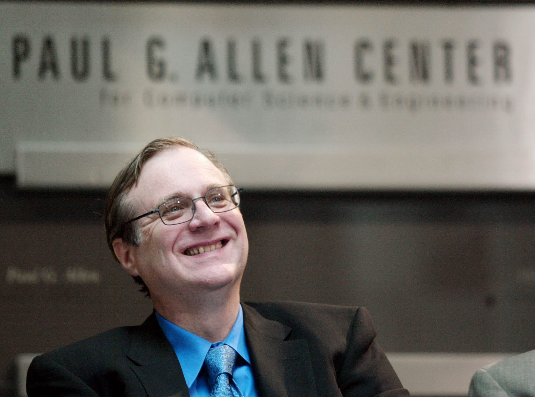 Paul Allen, Microsoft co-founder, smiles as he listens to other speakers during the dedication of the Paul G. Allen Center for Computer Science & Engineering at the University of Washington in Seattle on Thursday, Oct. 9, 2003. Allen died on Oct. 15, 2018. He was 65.