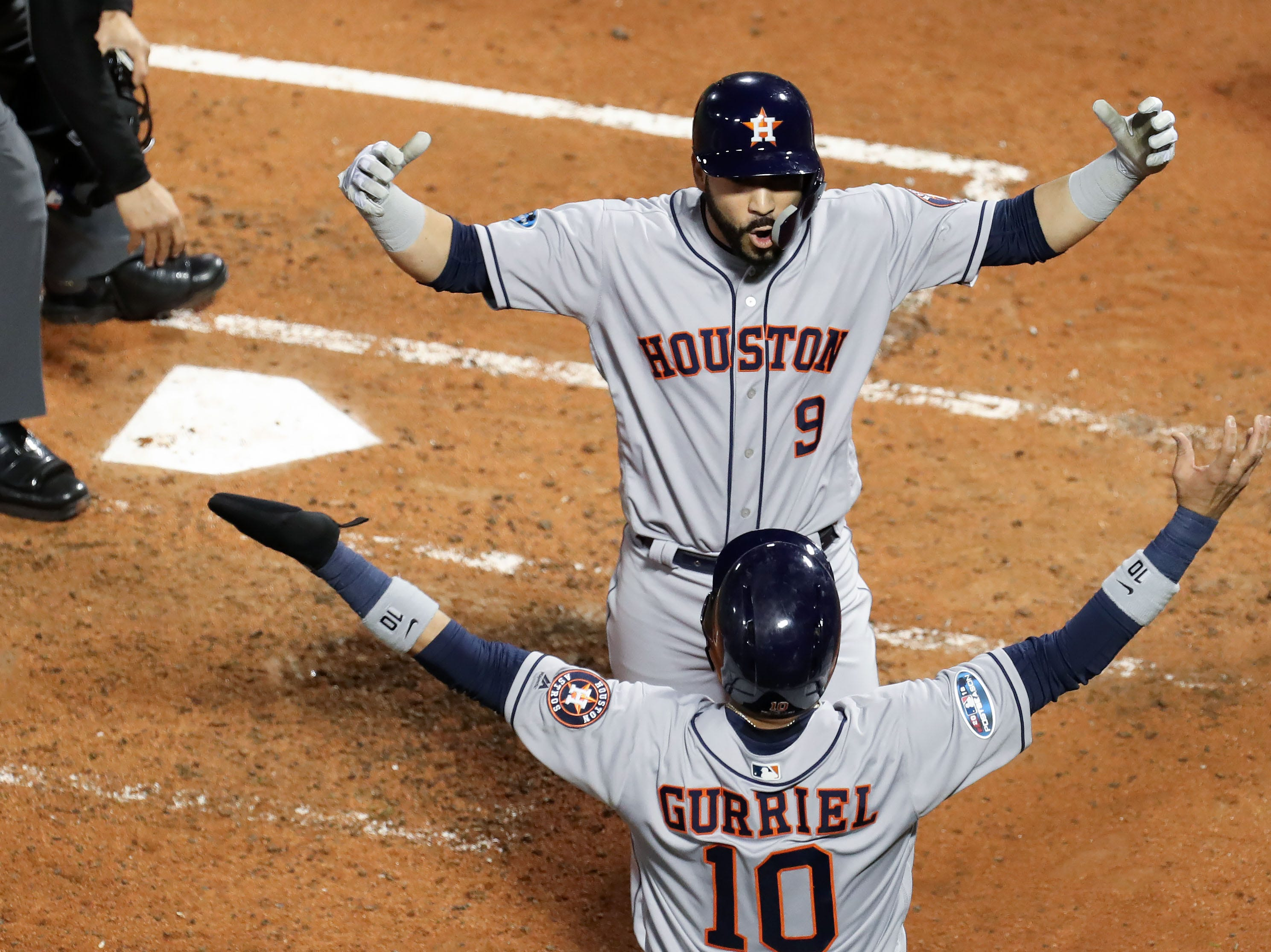 ALCS Game 2: Marwin Gonzalez celebrates his two-run homer in the third inning with teammate Yuli Gurriel.