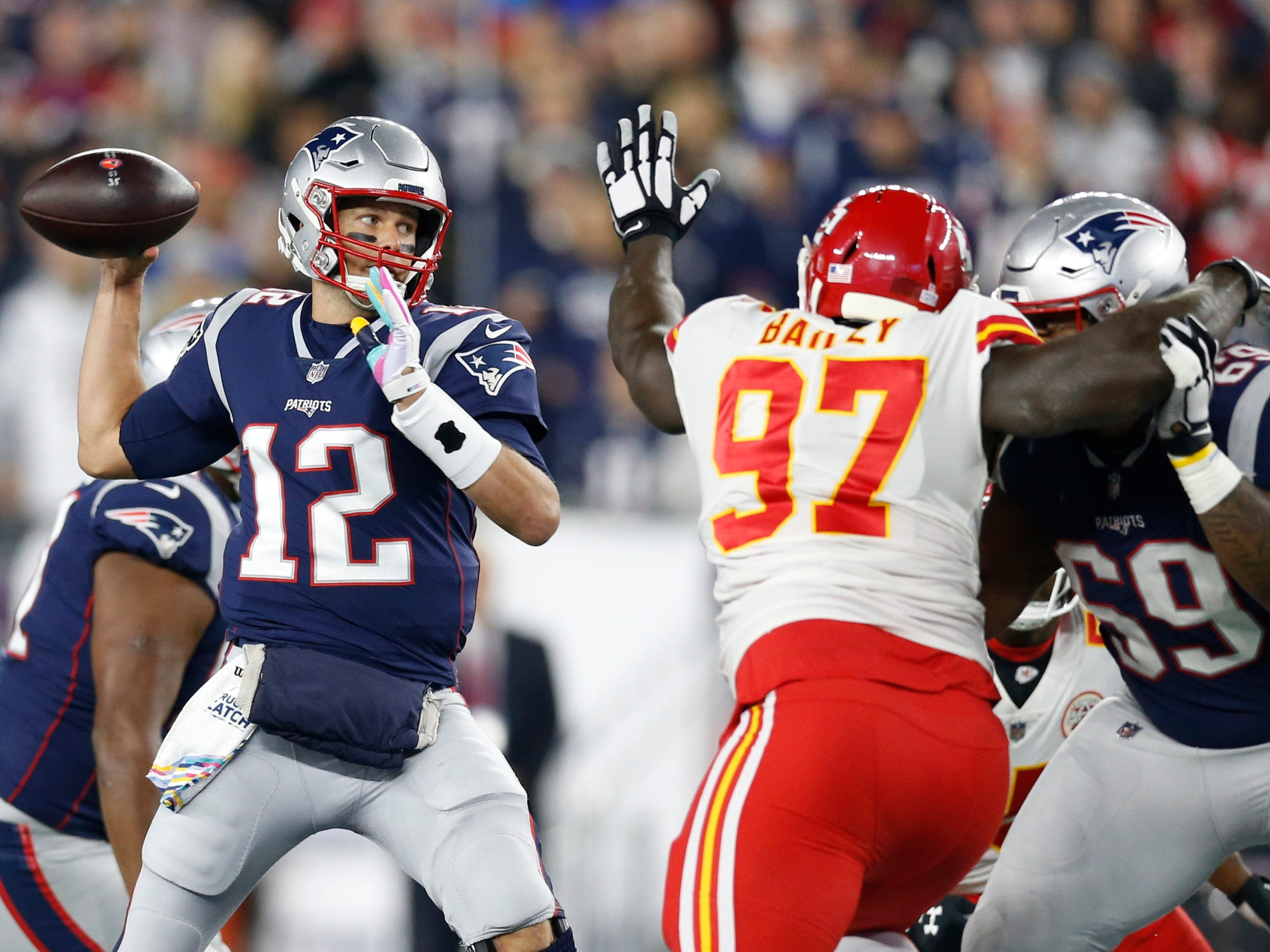 New England Patriots quarterback Tom Brady makes a pass while pressured by Kansas City Chiefs defensive end Allen Bailey during the first quarter at Gillette Stadium.