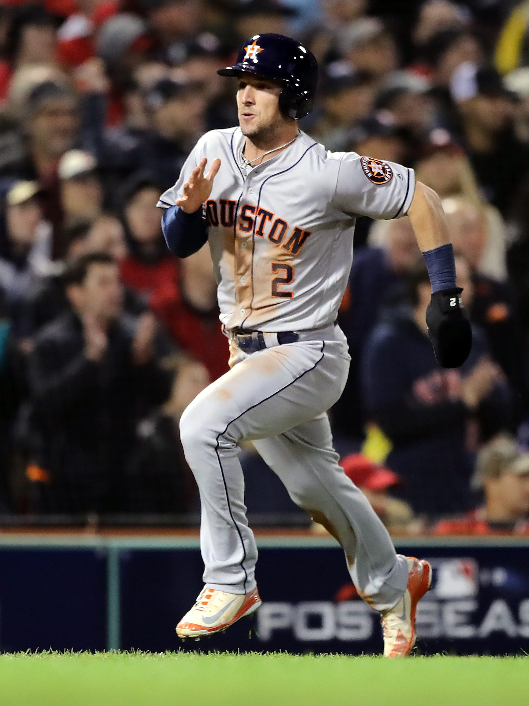 Bregman scores a run in Game 1 against the Red Sox.