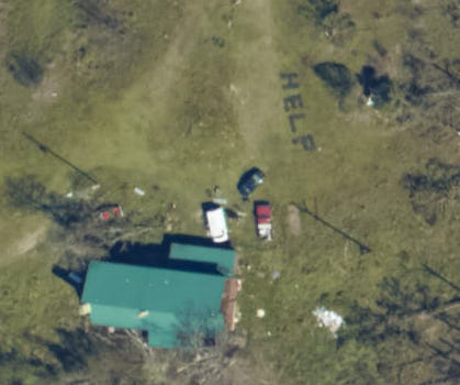 """NOAA National Geodetic Survey damage assessment imagery showing a home near Youngstown, Fla. where the word """"HELP"""" has been spelled out with logs after Hurricane Michael made landfall in Florida on Oct. 10, 2018."""