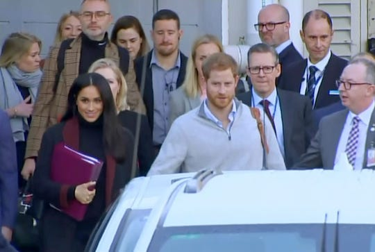 In this image from video, Prince Harry and Duchess Meghan of Sussex arrive in Sydney, Australia, on Oct. 15, 2018, a day before they start a 16-day tour of Australia and the South Pacific.