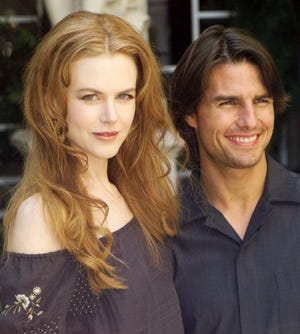 The 11-year marriage of Tom Cruise and Nicole Kidman ended in 2001. Here, the couple were all smiles during a photocall in Paris on Sept. 2, 1999.
