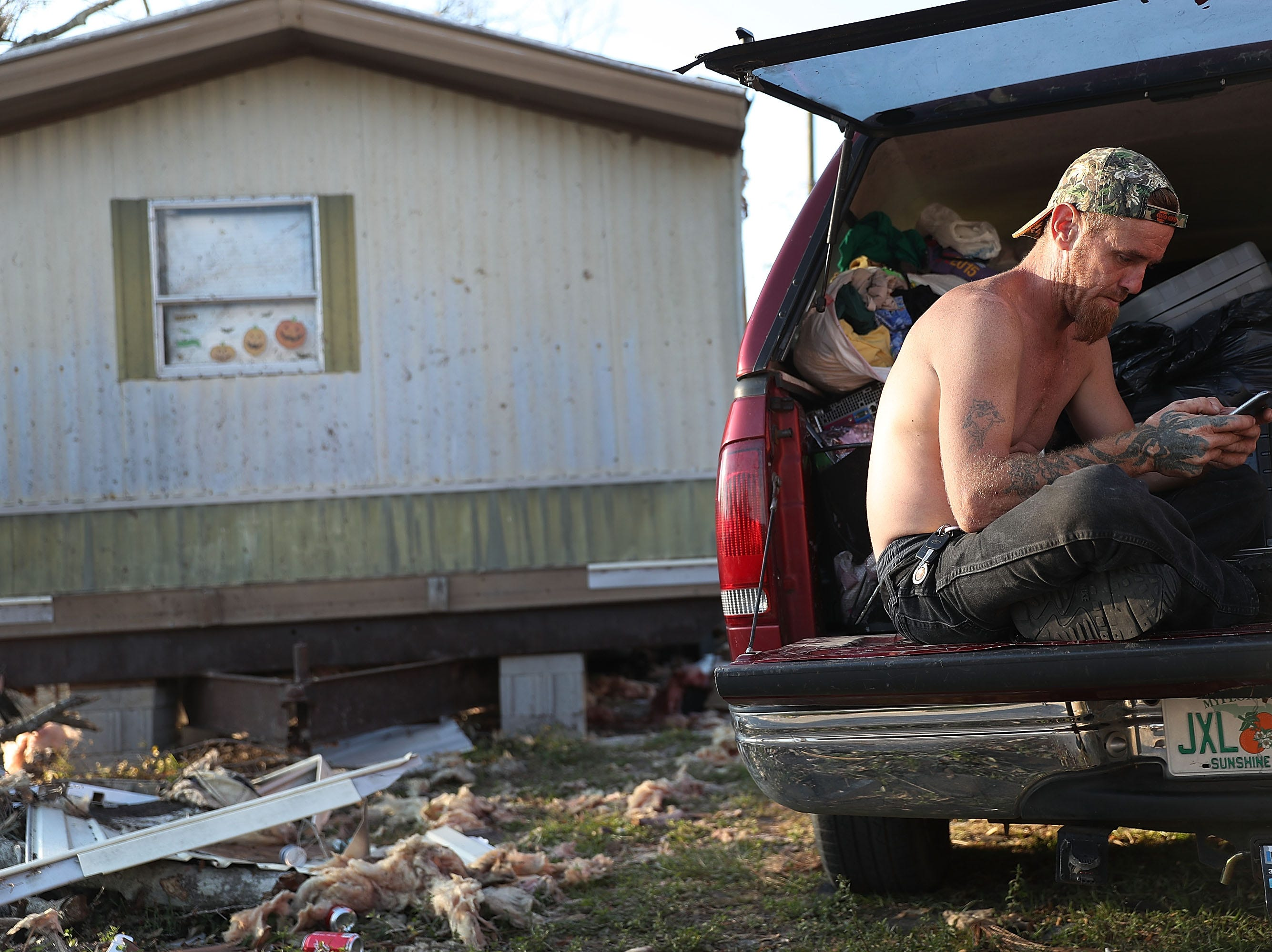 Nelson Cooper sits outside what is left of his home that was destroyed by Hurricane Michael as it passed through the area on Oct. 14, 2018 in Panama City, Fla. The hurricane hit the Florida Panhandle as a category 4 storm causing massive damage and claimed the lives of more then a dozen people.