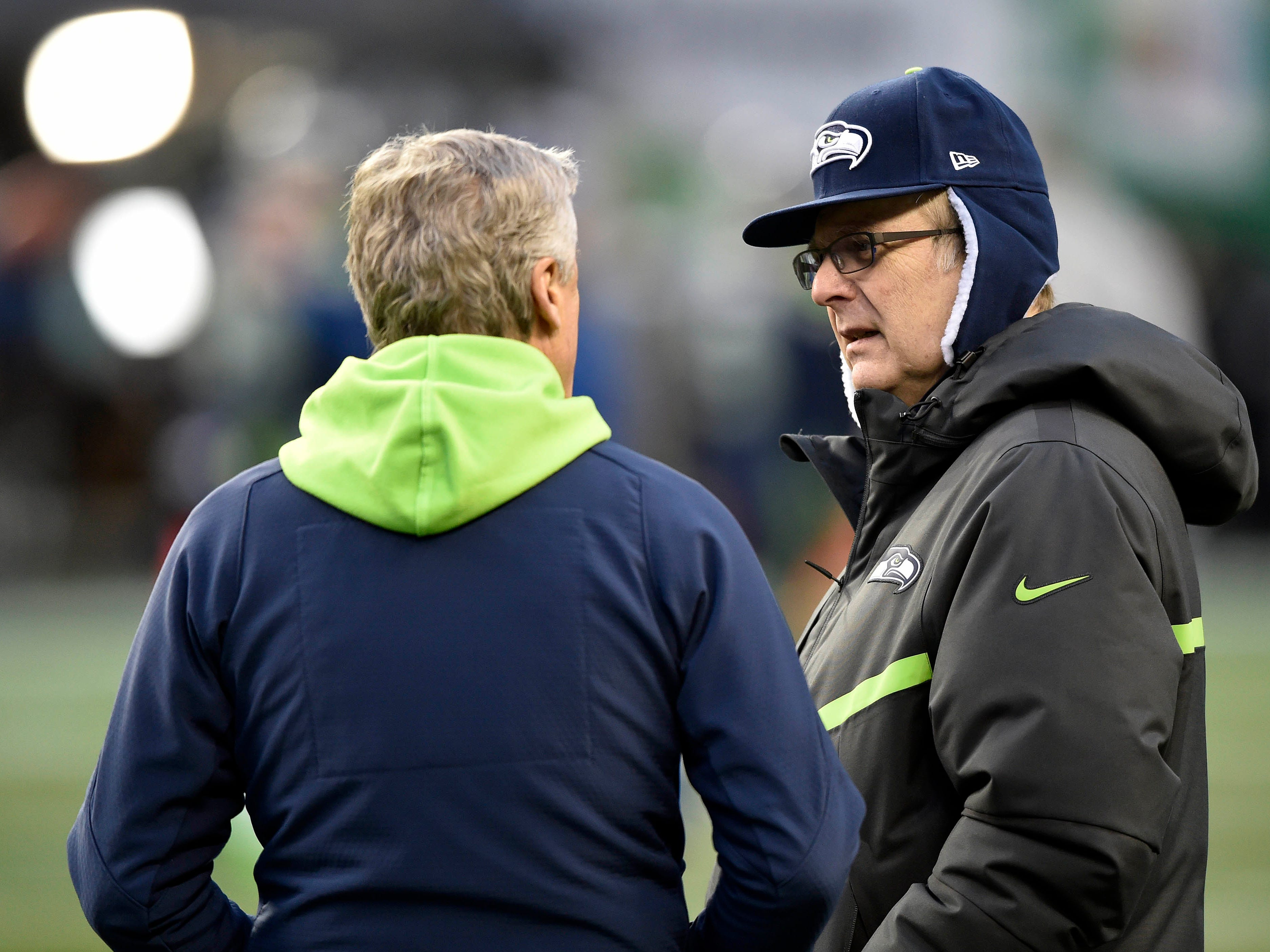 Seattle Seahawks majority owner Paul Allen, right, speaks with head coach Pete Carroll before the game against the Detroit Lions in the NFC Wild Card playoff football game in Seattle, Jan. 7, 2017.