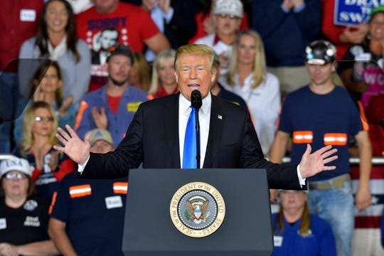 President Donald Trump speaks to a crowd at Eastern Kentucky University on Saturday in Richmond, Ky.
