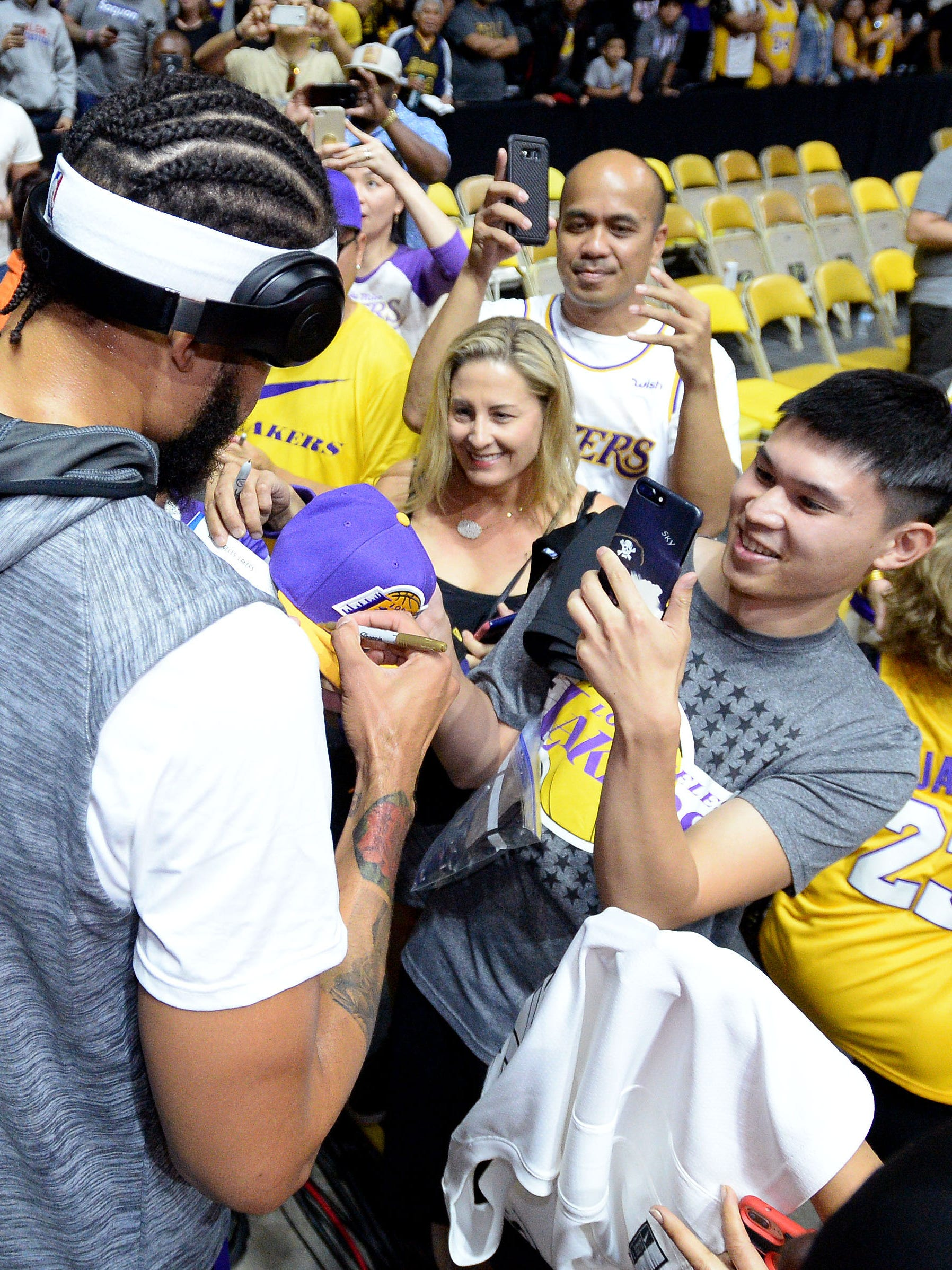 Lakers center JaVale McGee signs autographs for fans before the preseason game against the Nuggets last month.