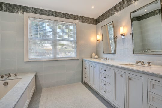 The Master bathroom features his and hers customized sinks.