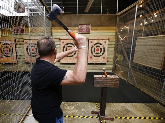 Stuart Josberger, co-owner of Stumpy's Hatchet House in Eatontown, throws an axe at the bullseye.
