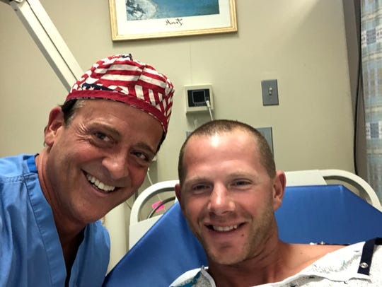 Dr. Stephen Chagares with patient Brian Thomson after using robotics to remove breast cancer tissue.